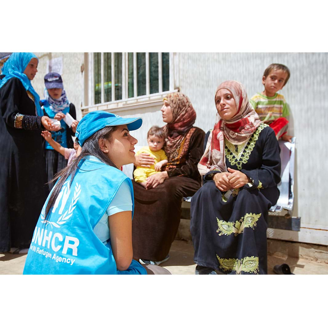 Syria - UNHCR staff with Syrian refugees